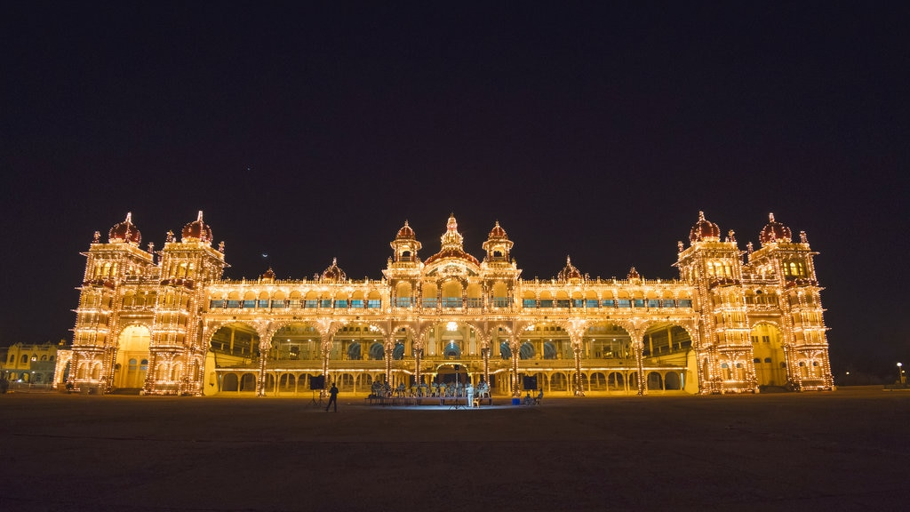 Mysore Palace showing chateau or palace, night scenes and heritage architecture