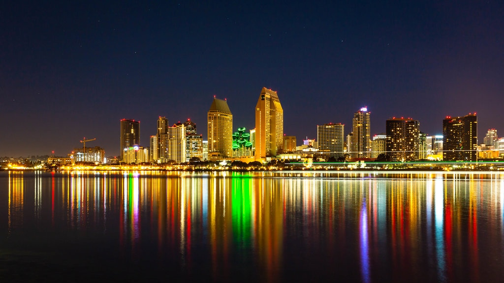 Southern California which includes a city, night scenes and a bay or harbor