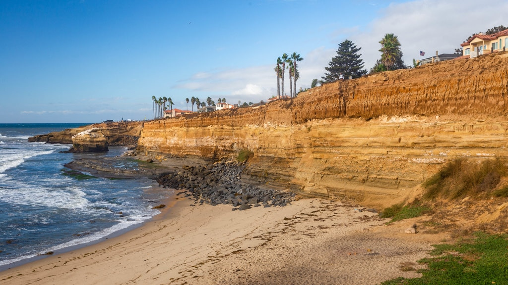 Southern California showing rocky coastline, a beach and general coastal views