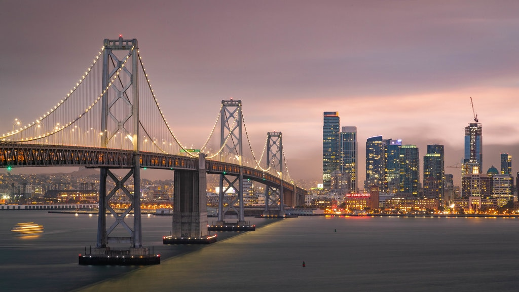 Bay Area featuring a bridge, night scenes and a sunset