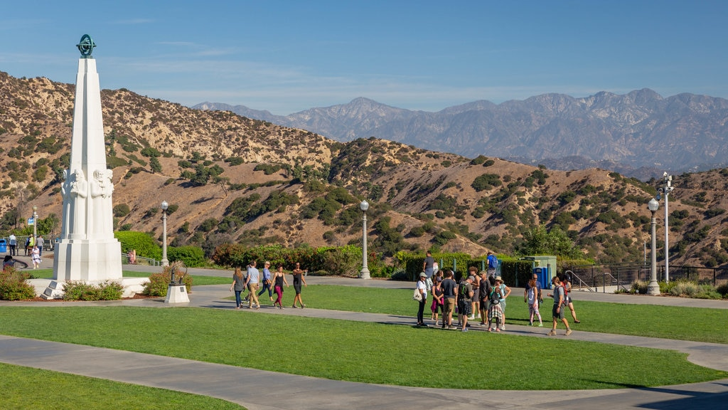 Griffith Observatory which includes a park as well as a small group of people