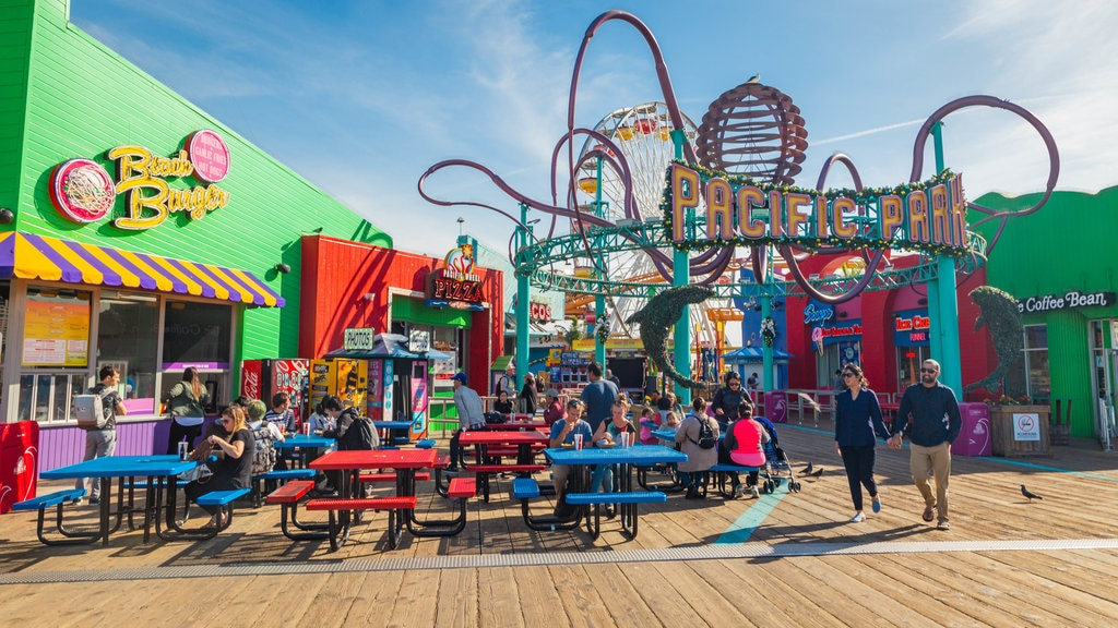 Santa Monica Pier which includes rides and signage as well as a couple