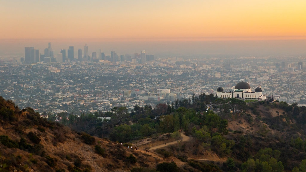 Griffith Park showing landscape views, mist or fog and a sunset