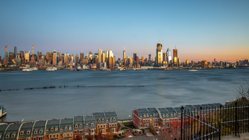 Weehawken which includes a city, a sunset and a bay or harbor
