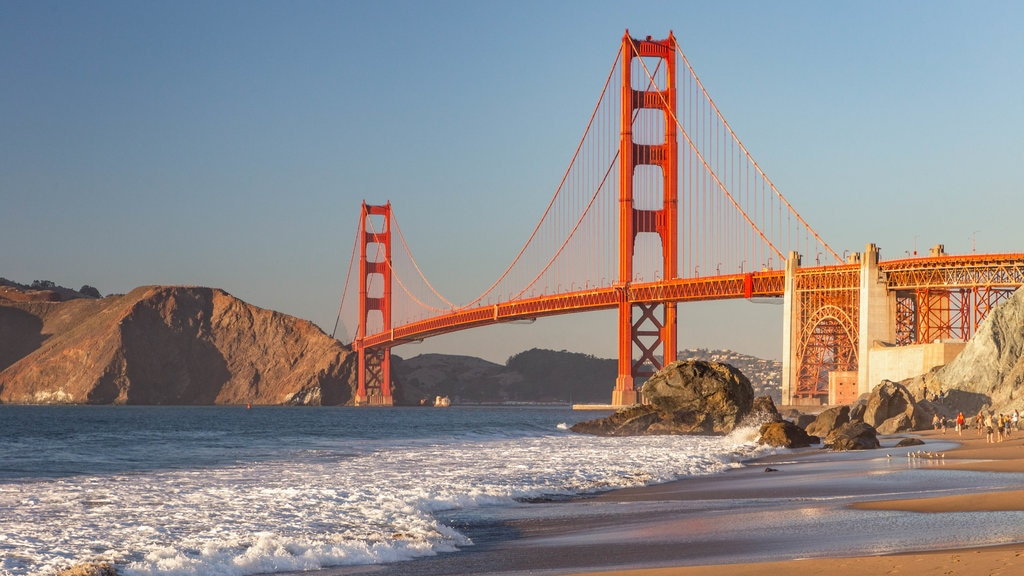 San Francisco which includes general coastal views, a bridge and a sunset