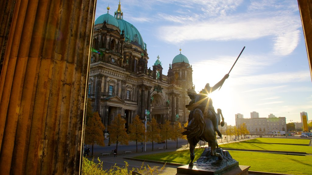 Berlin which includes a sunset, heritage architecture and a statue or sculpture