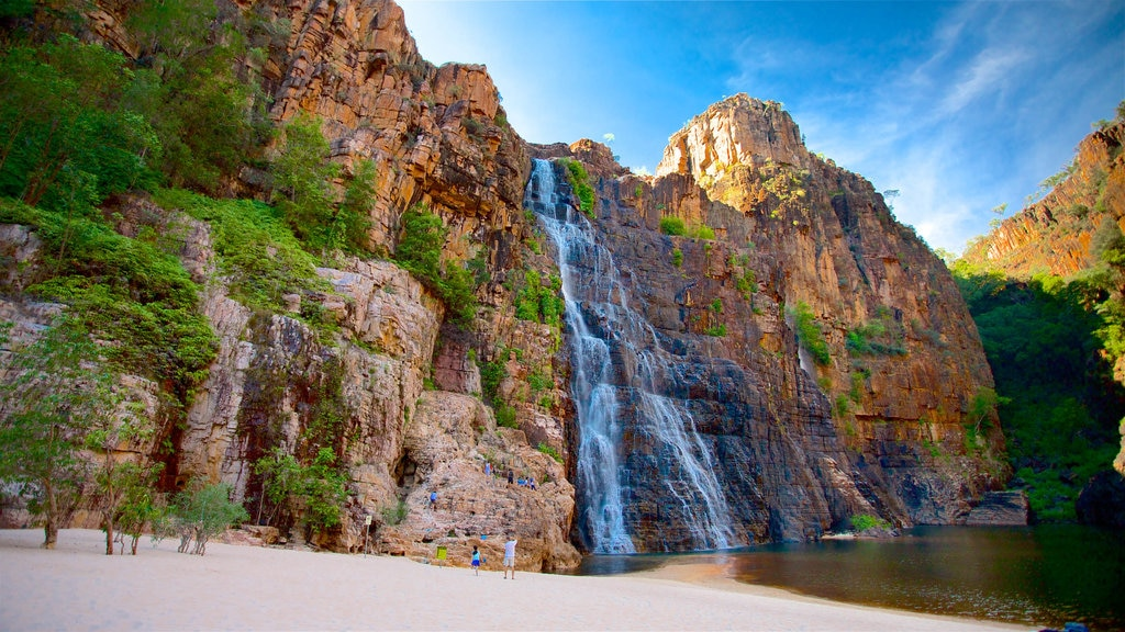 Twin Falls which includes a lake or waterhole, a beach and a waterfall