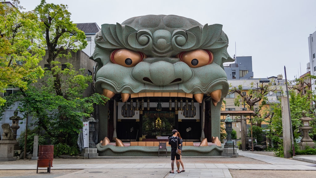 Namba Yasaka Shrine which includes street scenes and outdoor art as well as a couple