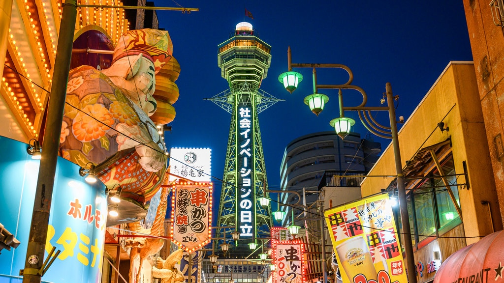 Tsutenkaku Tower which includes signage, a city and night scenes