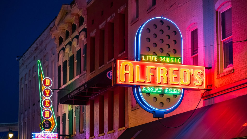 Beale Street featuring night scenes and signage
