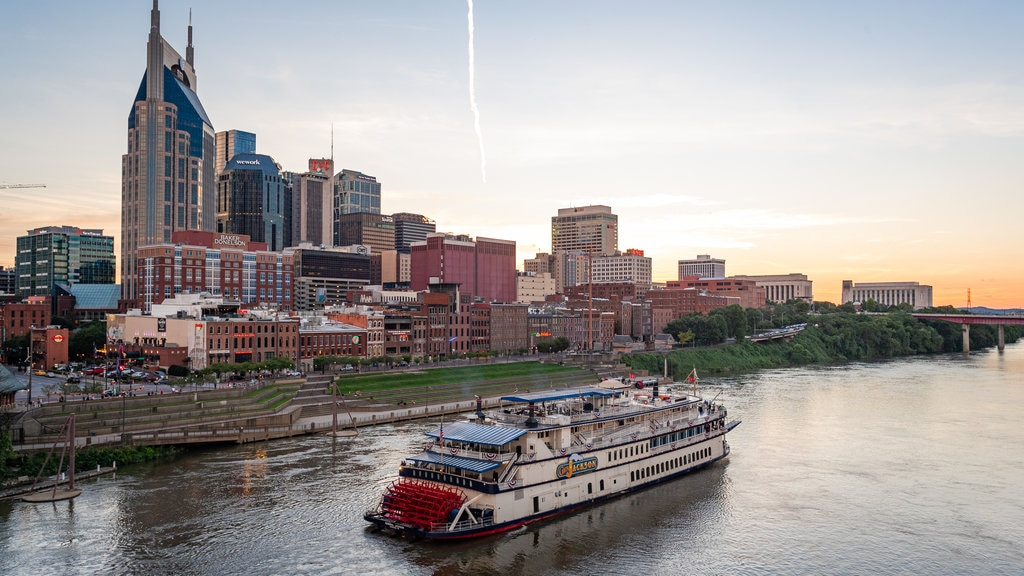 Downtown Nashville which includes a sunset, a city and landscape views