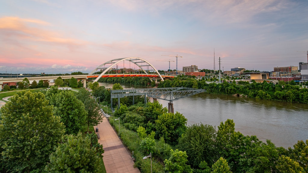 Downtown Nashville featuring a sunset, a river or creek and a park