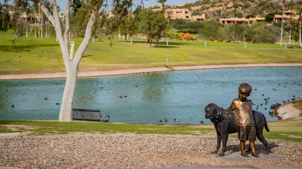 Fountain Hills Fountain featuring outdoor art, a garden and a pond