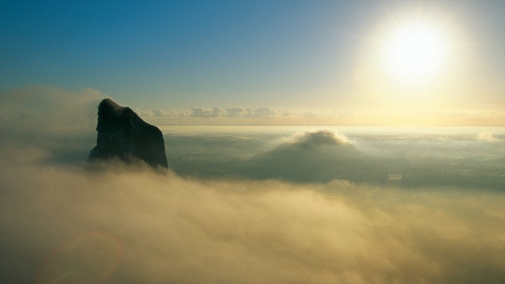 Glasshouse Mountains National Park showing mountains, mist or fog and landscape views