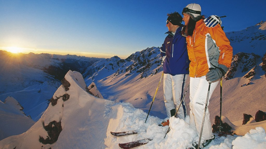 Lech am Arlberg which includes mountains, a sunset and snow skiing