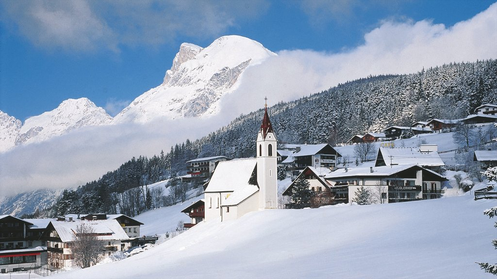 Seefeld in Tirol which includes a small town or village, mountains and a church or cathedral