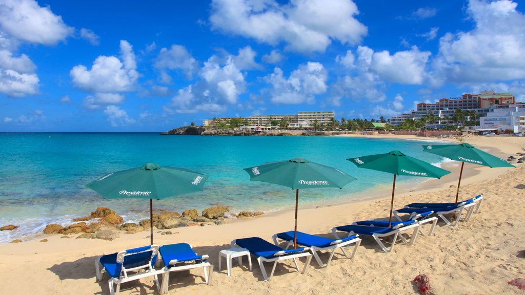 Maho Reef which includes a beach, a coastal town and a luxury hotel or resort