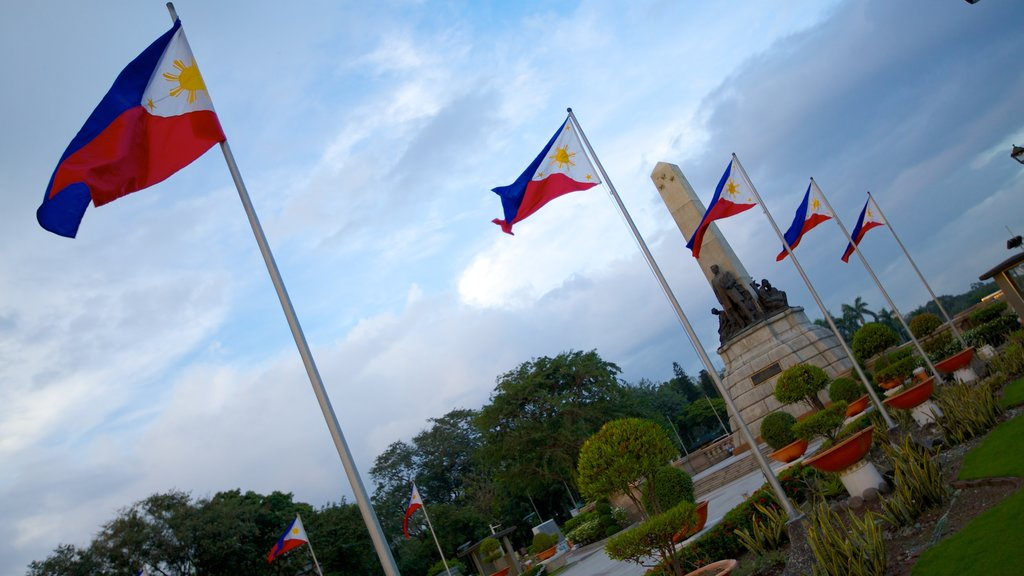 Rizal Park featuring a garden and a monument