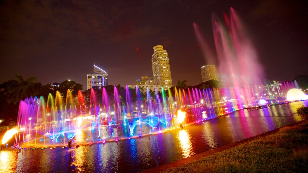 Rizal Park showing a garden, a fountain and night scenes