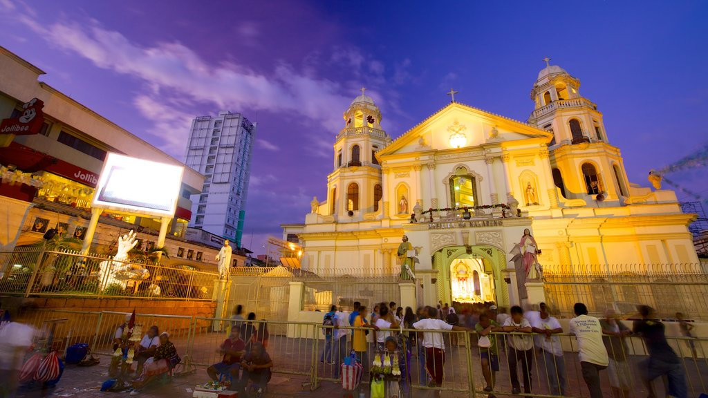 Quiapo Church showing night scenes, heritage architecture and a city