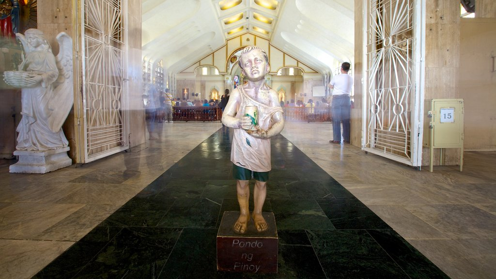 Quiapo Church showing interior views, a statue or sculpture and religious elements