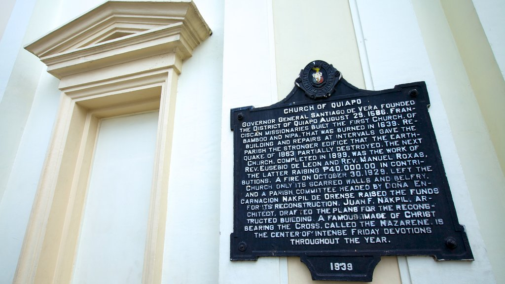 Quiapo Church featuring signage, a church or cathedral and religious aspects