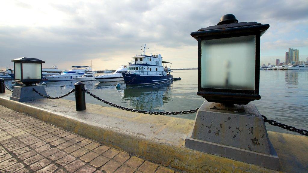 Baywalk featuring a marina, a coastal town and a city