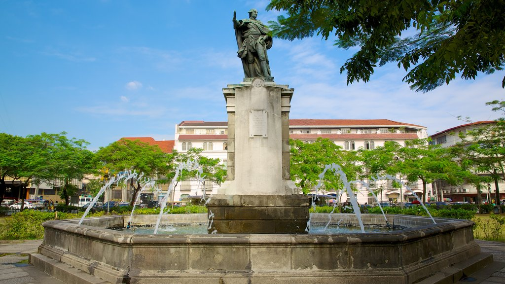 Manila Cathedral featuring a statue or sculpture, outdoor art and a city