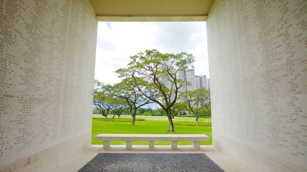 Manila que incluye una ciudad, un cementerio y un monumento