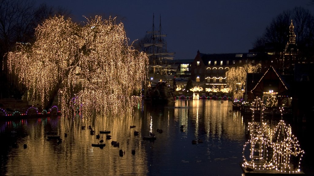 Tivoli Gardens featuring night scenes, a park and a pond