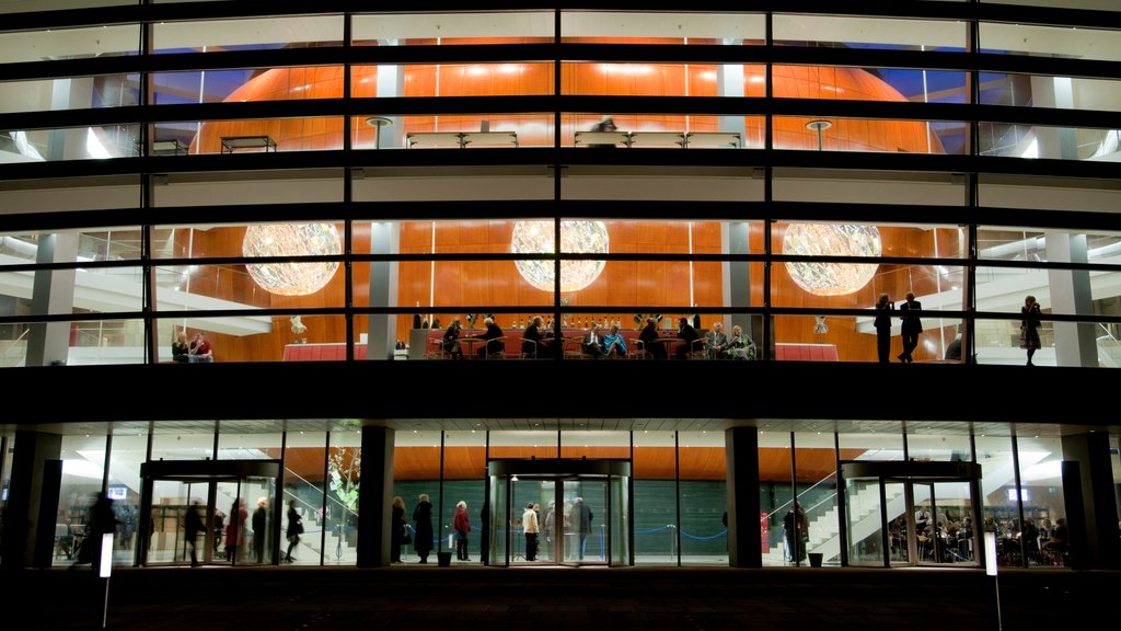 Copenhagen Opera House showing theater scenes, night scenes and modern architecture