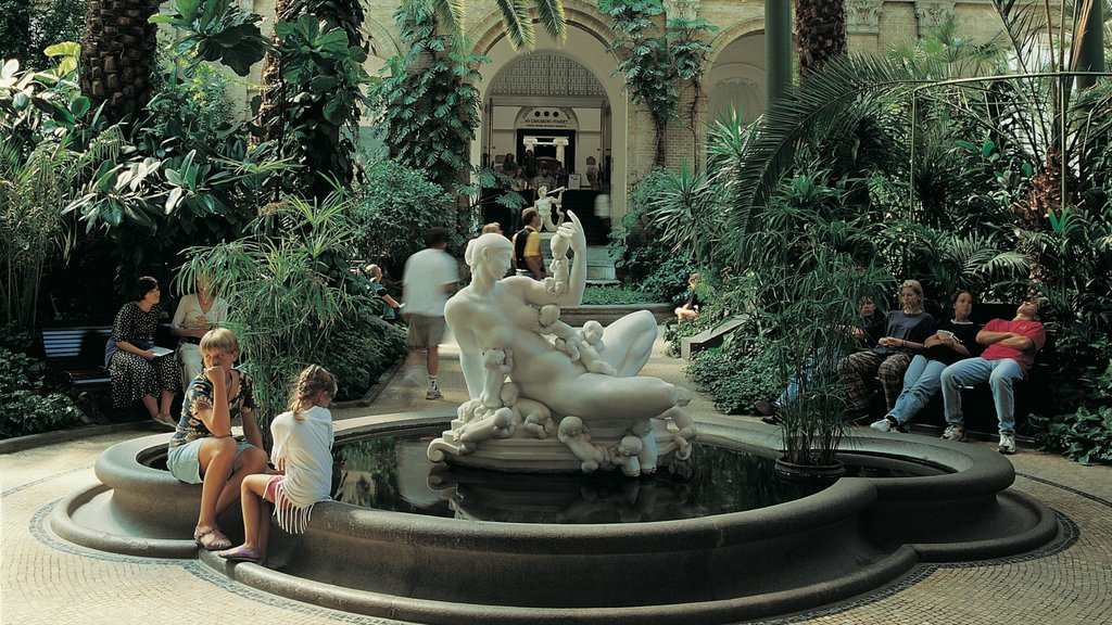 Ny Carlsberg Glyptotek showing a garden, a statue or sculpture and outdoor art
