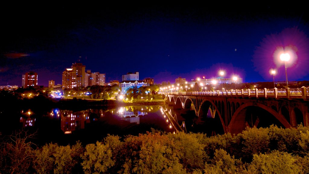 Saskatoon which includes night scenes, a bridge and a city