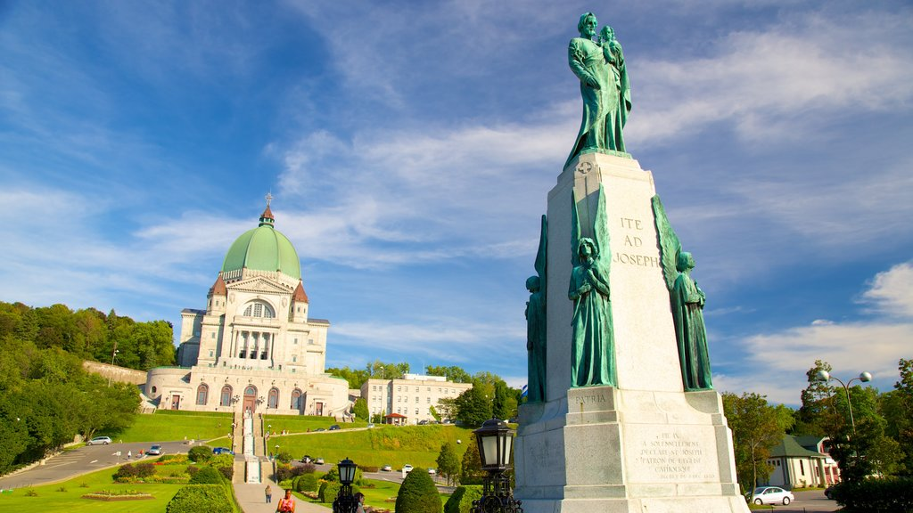 Saint Joseph\'s Oratory showing a statue or sculpture, heritage architecture and a city
