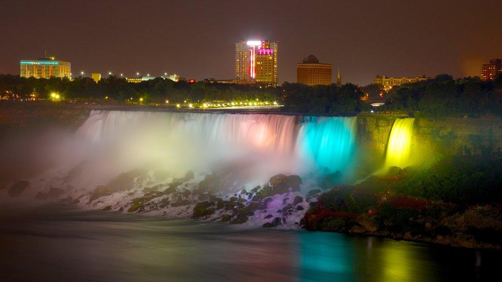 Niagara Falls showing night scenes and a waterfall