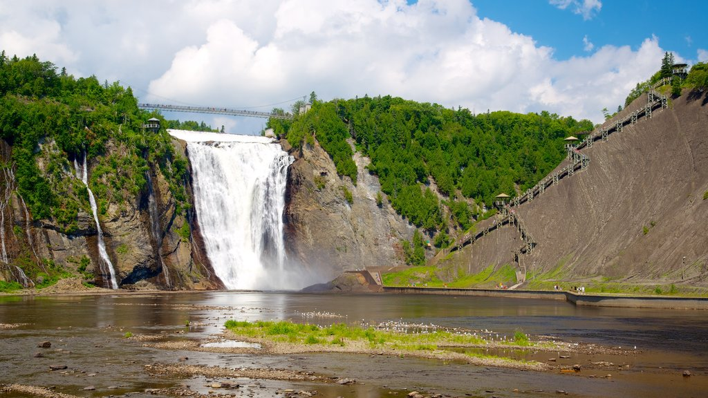 Montmorency Falls showing a cascade and a suspension bridge or treetop walkway