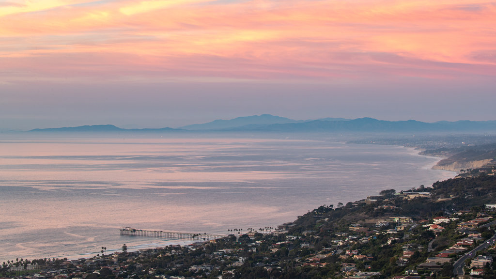 Mount Soledad which includes a sunset, a coastal town and general coastal views
