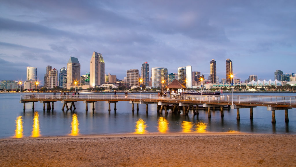 Coronado Ferry Landing featuring a sandy beach, a city and a sunset