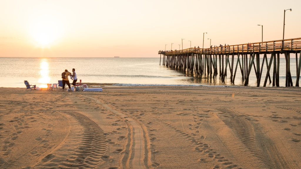 Virginia Beach which includes a sunset, a beach and general coastal views
