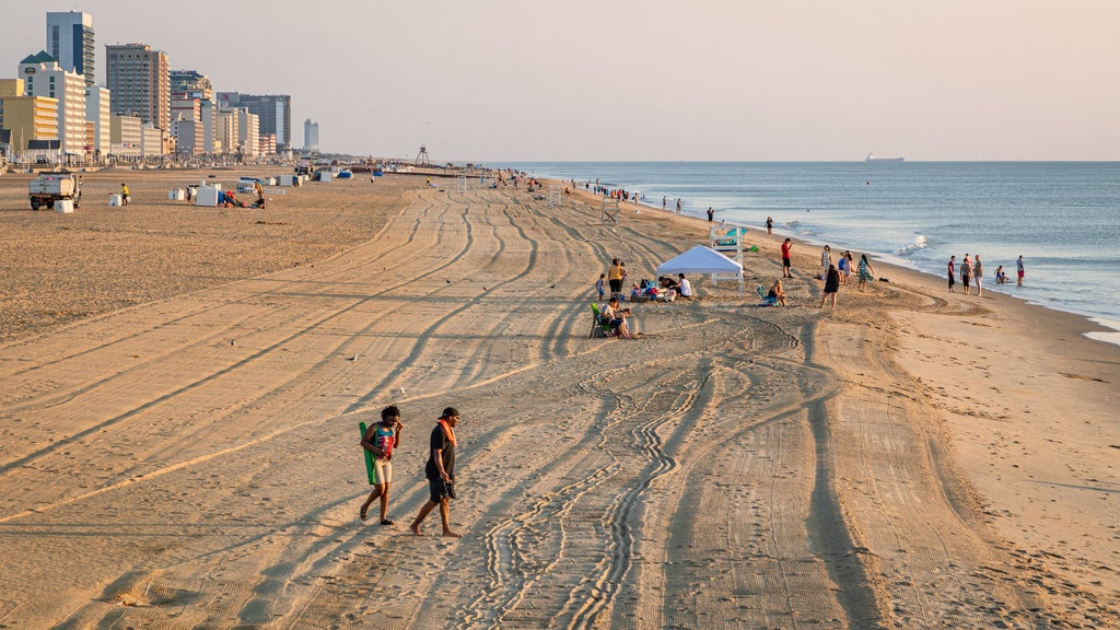 Virginia Beach showing a sunset, a beach and a coastal town