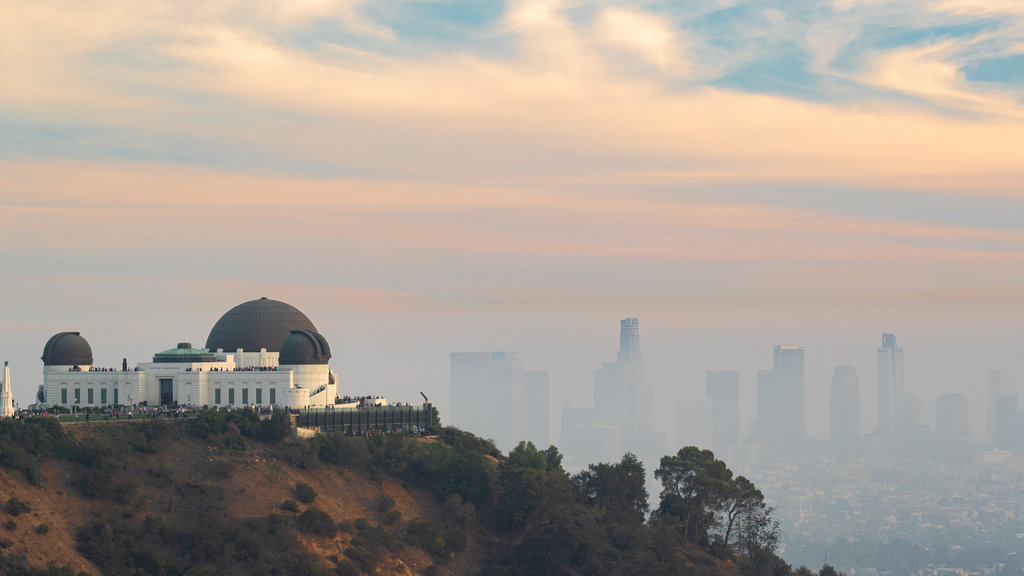 Griffith Observatory featuring a sunset, mist or fog and an observatory