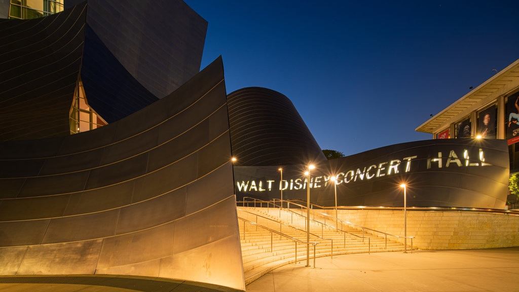 Walt Disney Concert Hall featuring signage and night scenes
