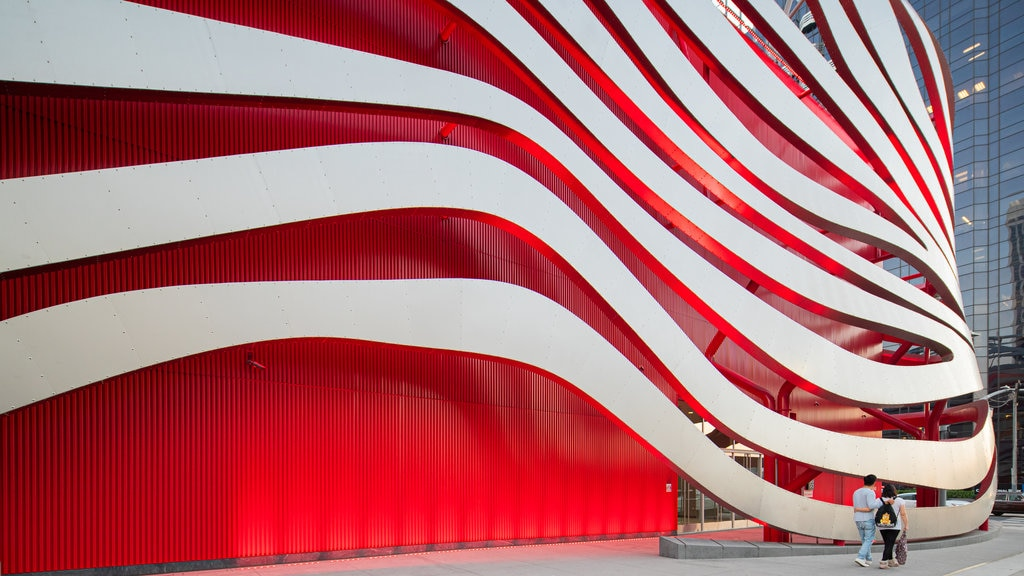 Petersen Automotive Museum featuring street scenes and modern architecture as well as a couple