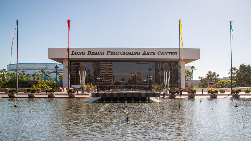 Downtown Long Beach featuring signage, a lake or waterhole and a fountain