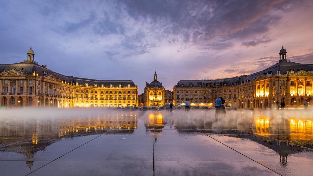 Place de la Bourse featuring heritage architecture, night scenes and a sunset