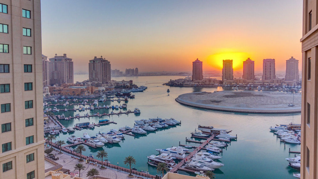 The Pearl-Qatar featuring a bay or harbor, a city and a sunset