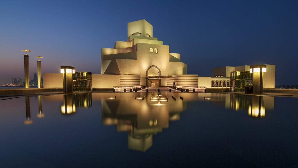 Museum of Islamic Art showing a pond, night scenes and modern architecture
