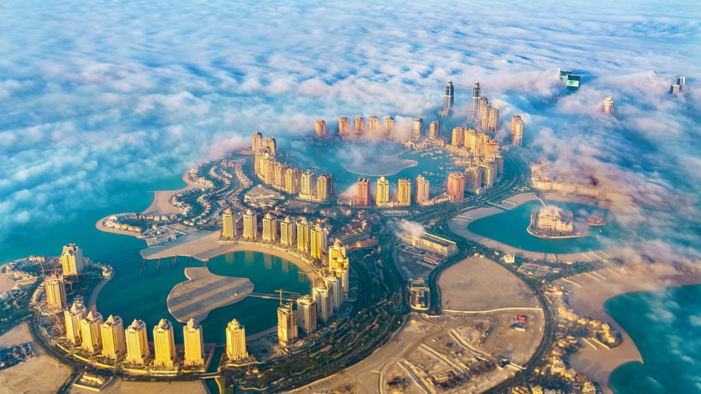 The Pearl-Qatar which includes a city, landscape views and mist or fog