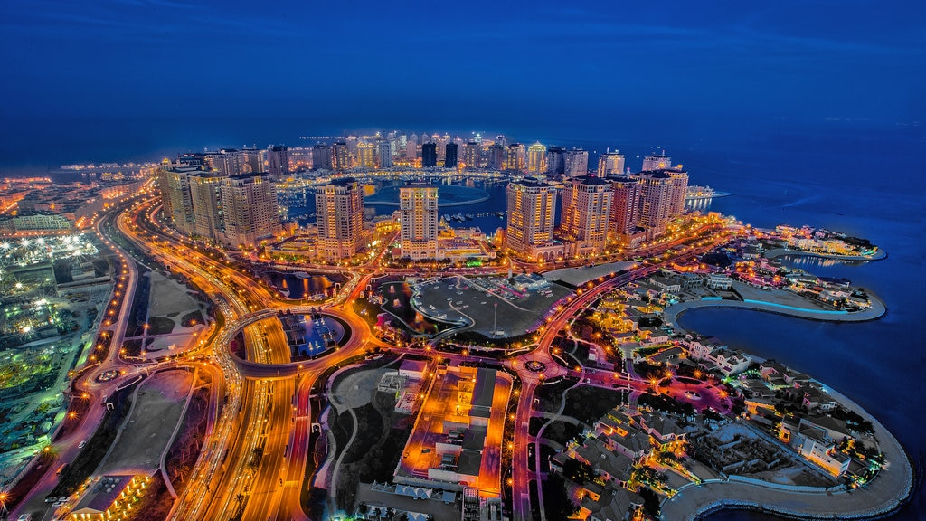 The Pearl-Qatar featuring night scenes, a coastal town and a bay or harbor