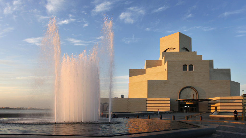 Museum of Islamic Art featuring a fountain and a sunset